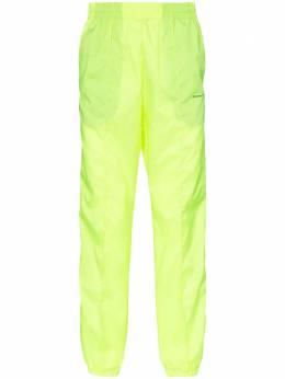 Off-White спортивные брюки с лампасами и логотипом OMCA090S19D160016200