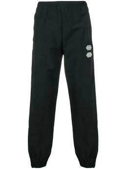 Off-White эластичные брюки OMCA085R19C010211000