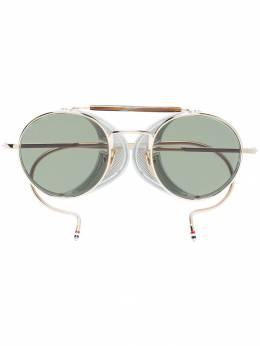 Thom Browne Eyewear солнцезащитные очки в круглой оправе TB001BT48