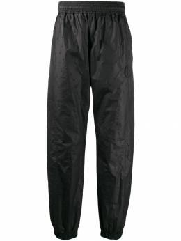 Off-White спортивные брюки с фактурной отделкой OMCA096E19E140021000