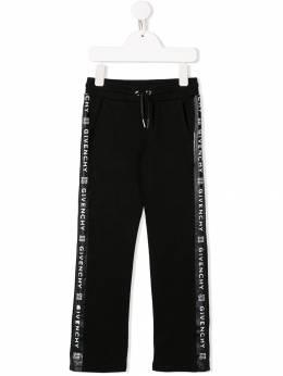 Givenchy Kids спортивные брюки с логотипом на лампасах H1406109B