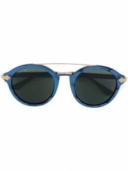 Gucci Eyewear солнцезащитные очки в круглой оправе GG0090S