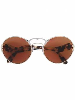 Prada Eyewear солнцезащитные очки в круглой оправе SPR55T
