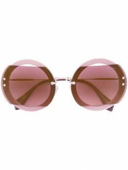 Miu Miu Eyewear солнцезащитные очки в круглой оправе SMU06S