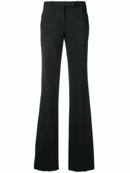 Etro расклешенные брюки с лампасами 132180524