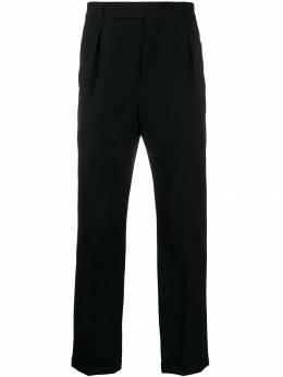 Saint Laurent брюки строгого кроя с манжетами 563592Y028V