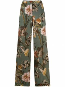 Off-White расклешенные брюки с цветочным принтом OWCA082E19B170854199