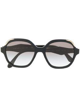 Prada Eyewear солнцезащитные очки в круглой оправе PR06US1AB0A752