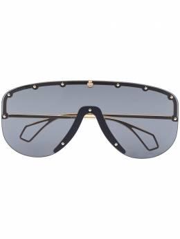 Gucci Eyewear солнцезащитные очки с затемненными линзами GG0667S001
