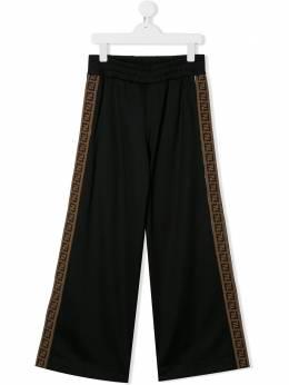Fendi Kids расклешенные брюки с узором FF JUF015A69D