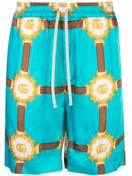 Gucci спортивные шорты с принтом GG 574900ZABU9