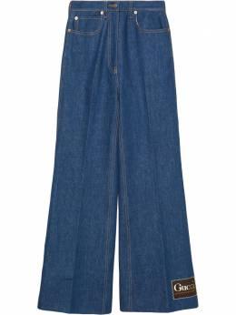 Gucci расклешенные джинсы с логотипом 623441XDBCY