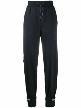 Off-White спортивные брюки с декорированными манжетами OWCA079E20FAB0011000