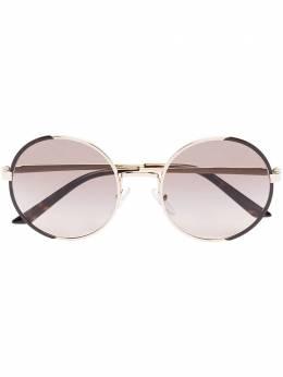 Prada Eyewear солнцезащитные очки в круглой оправе 0PR59XS