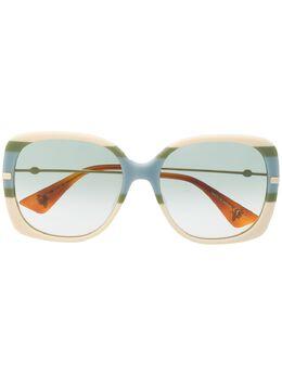 Gucci Eyewear солнцезащитные очки в массивной оправе в полоску 573203J0740