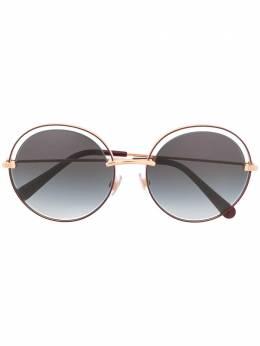 Dolce&Gabbana Eyewear солнцезащитные очки в круглой оправе с вырезами DG2262