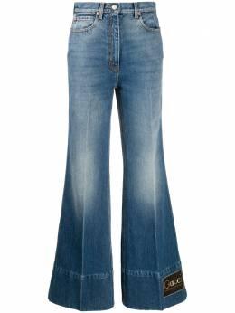 Gucci расклешенные джинсы с логотипом 623441XDBDJ