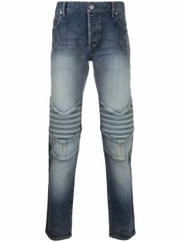 Balmain Tapered-fit logo embossed denim jeans UH05108Z170
