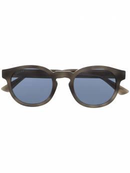 Gucci Eyewear солнцезащитные очки в круглой оправе с принтом GG0825S004
