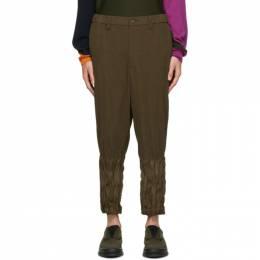 Issey Miyake Men Khaki Corduroy Tapered Twist Trousers ME08FF082