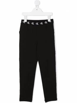 Calvin Klein Kids спортивные брюки с монограммой IG0IG00829BEH