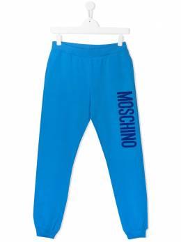 Moschino Kids спортивные брюки с логотипом HMP03LLDA27