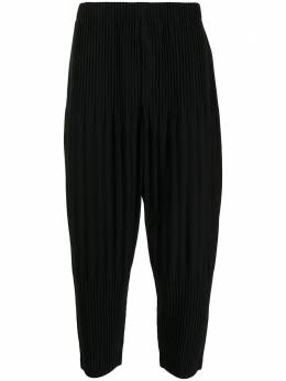 Homme Plisse Issey Miyake pleated tapered-leg trousers HP16JF151
