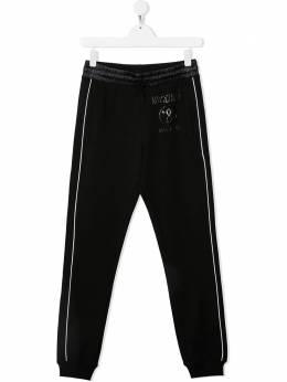 Moschino Kids спортивные брюки с логотипом HUP04KLDA25