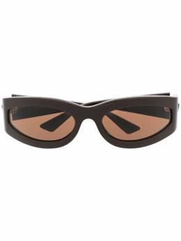 Bottega Veneta Eyewear затемненные солнцезащитные очки в овальной оправе BV1089S