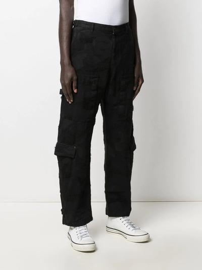 Valentino брюки из денима с камуфляжным принтом VV3DD00R724 - 3